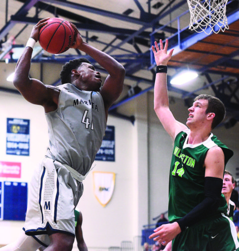 Photo courtesy of Nate Knobel Marietta College's Avery Williams, left, goes up with the ball during a college men's basketball game against Wilmington Saturday at Ban Johnson Arena.