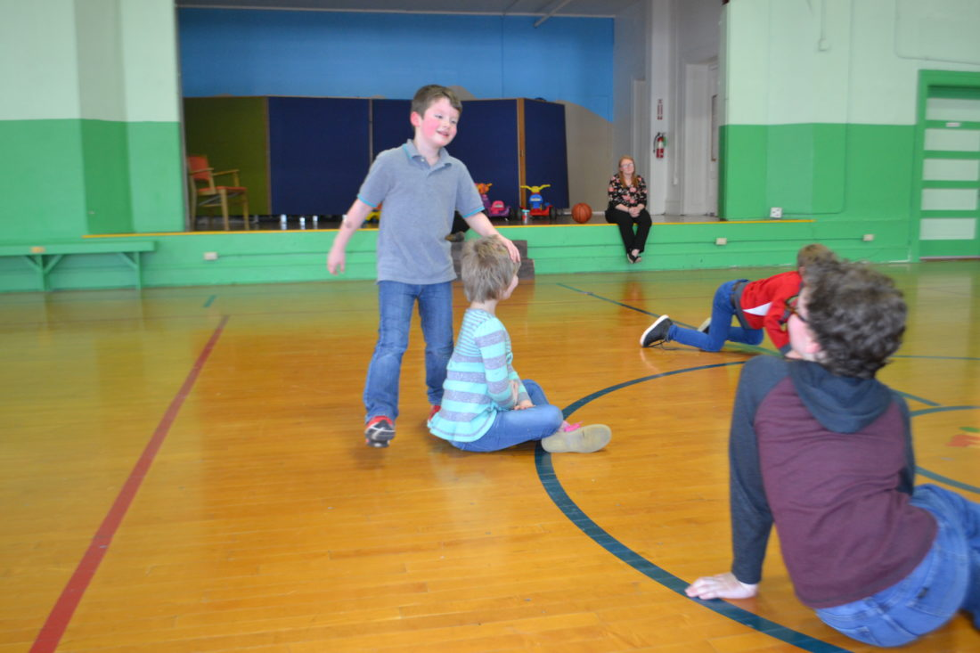 """MICHAEL KELLY   The Marietta Times Children play """"duck duck goose"""" in the gymnasium at the Ely Chapman Education Foundation on Scammel Street Monday afternoon. The center is a summer food location designated by the U.S. Department of Agriculture."""