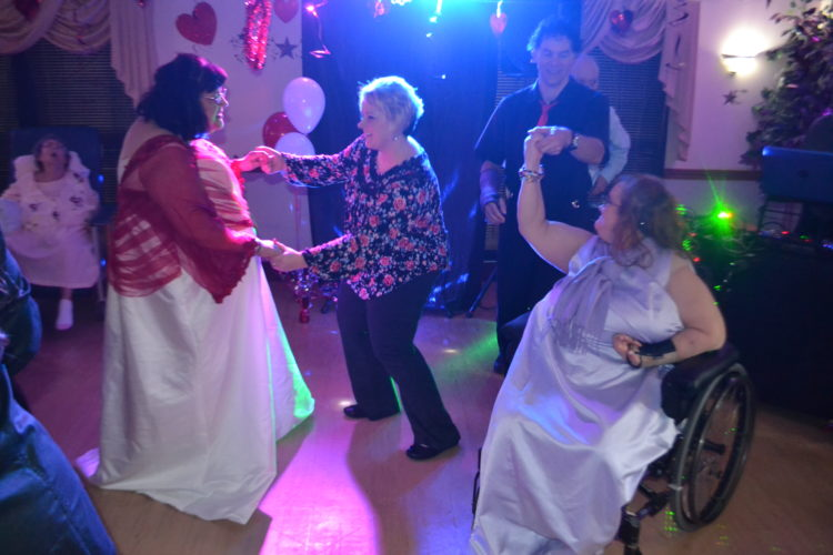 MICHAEL KELLY   The Marietta Times Residents, staff and visitors dance at the Thursday day-after-Valentine's party at the Muskingum Valley Nursing and Rehabilitation in Beverly.