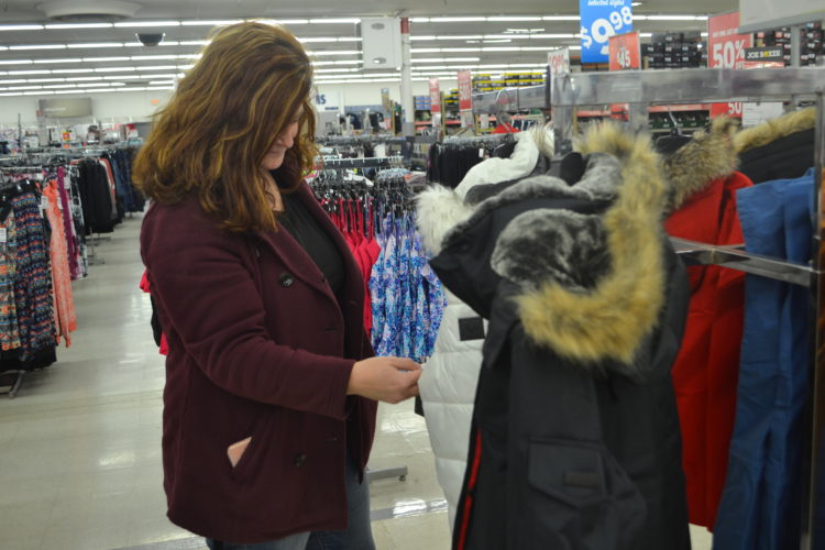 ERIN O'NEILL  The Marietta Times Heather Ray, of Belpre, looks over the limited number of winter coats at Marietta Kmart Tuesday. February is a good month to look for deals on things like coats, hats, gloves and boots.