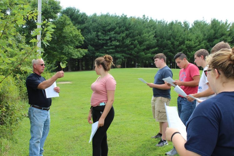 Photo submitted by Sierra Sinclair Allen Clark, ag teacher and FFA advisor for Warren High School, instructs a group of sophomores in leaf identification.