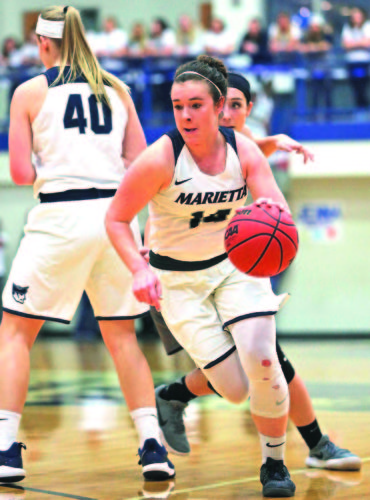 Photo courtesy of Rebecca Wheeler Marietta College's Brooke Borich handles the ball during a college women's basketball game against Ohio Northern Saturday at Ban Johnson Arena.