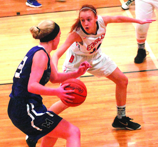 STEVE HEMMELGARN The Marietta Times Belpre's Khyleigh Scott, right, guards Miller's Sophia Compston during Saturday's sectional final at Meigs High in Pomeroy.