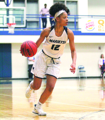 Photo courtesy of France Moise Marietta College's Shay Lett handles the ball during a college women's basketball Ohio Athletic Conference Tournament quarterfinal matchup against John Carroll Tuesday at Ban Johnson Arena.