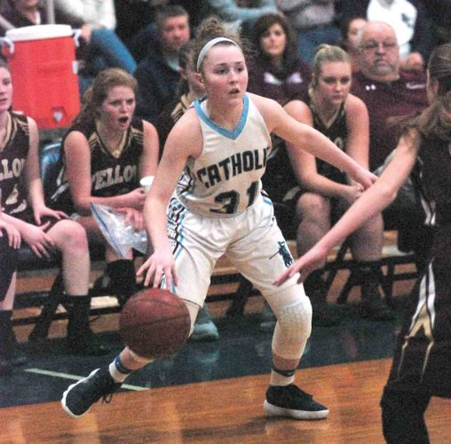 JOE ALBRIGHT The Marietta Times Parkersburg Catholic's Madeline Huffman (31) handles the ball during a high school girls Class A, Region IV, Section 1 championship basketball game Thursday in Parkersburg. Catholic defeated Williamstown, 73-60.