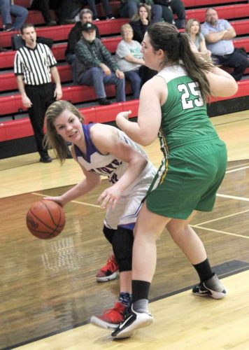Fort Frye's Liv Schneider, left, makes a move with the ball as Conotton Valley's Carly Caldwell defends during a high school girls Division IV sectional semifinal Thursday in Beverly. TOM PERRY The Marietta Times