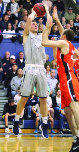 Photo courtesy of France Moise Marietta College's Kyle Dixon (21) goes up for a jumper during Thursday's Ohio Athletic Conference Tournament semifinal game against Ohio Northern at Ban Johnson Arena.