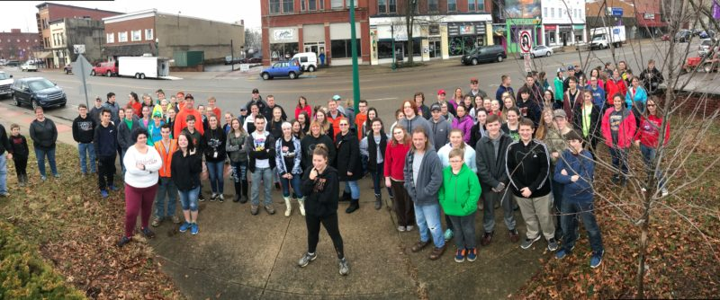 Marietta high School students arrive downtown to help businesses.