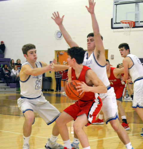 RON JOHNSTON The Marietta Times Warren's Troy Huck, left, and Jared Hall double-team Logan Elm's Isaac Ward during a high school boys Division II sectional final game Friday night at Jim Myers Gymnasium in Logan. Warren won, 45-36.
