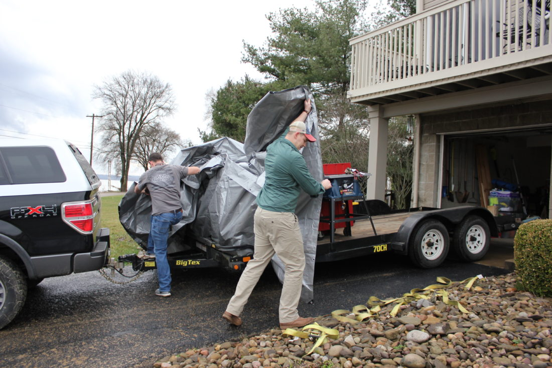 JANELLE PATTERSON   The Marietta Times Jeff Bolde, 33, left, and his brother Joseph Warren, 33, right, both of South Carolina, load a trailer with the contents of their mother, Carol Bolde's, basement at the Win Beri Condos in Harmar Friday.