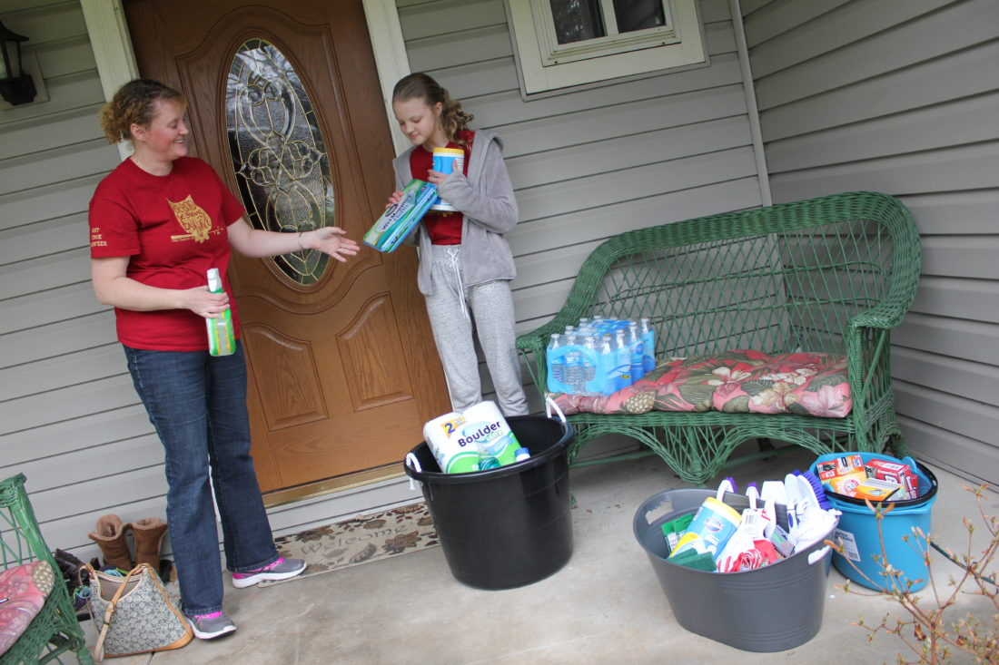Audrey Space, right, and her mother Addie, gather cleaning supplies Saturday to be donated to those impacted by flooding this weekend.