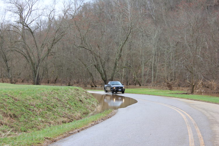 JANELLE PATTERSON   The Marietta Times High water on Hills Bridge Road near Ohio 26 Sunday.