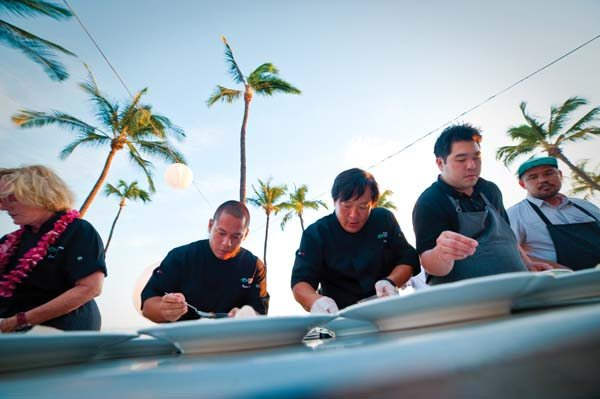 At last year's Hawai'i Food & Wine Festival at Hyatt Regency Maui Resort & Spa, chefs included Isaac Bancaco of Andaz Maui (from left), TV personality Ming Tsai (who will film at this year's Chef's Paradise event) and Chris Kajioka of the soon to open, highly anticipated Senia in Oahu's Chinatown. Hawai'i Food & Wine Festival photo