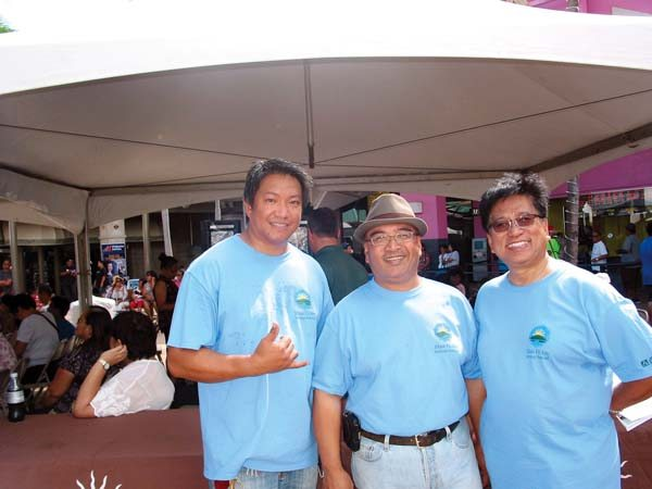 Event planner Jake Belmonte (from left) and visionary founders Sen. Gilbert Keith-Agaran and Alfredo Evangelista are all smiles at Maui Mall at a previous Maui Fil-Am Festival. The Maui News / CARLA TRACY photo