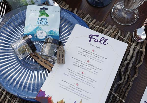 A menu shows the dishes paired with strains of pot during a dinner for invited guests at Planet Bluegrass in Lyons, Colo., on Oct. 2. Chefs and pot growers trying to explore fine dining with weed face a legal gauntlet to make pot dinners a reality, even where the drug is legal.   AP photo