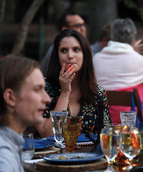 A diner smokes marijuana during an event pairing fine food and craft marijuana strains in Lyons, Colo., on Oct. 2.  AP photo