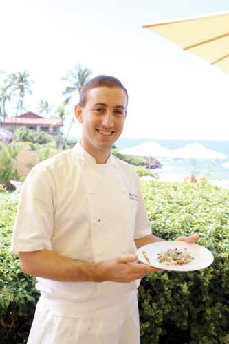 Four Seasons Executive Sous Chef Marco Calenzo presents thinly sliced poached octopus with parsley potato, celery heart, arugula and sweet lemon.  The Maui News / CARLA TRACY photo