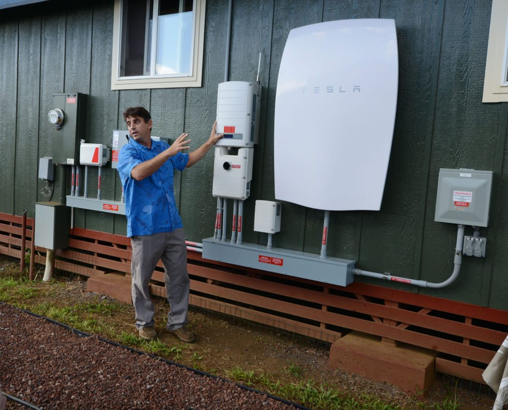 Rising Sun co-owner Brad Albert describes the capabilities of the Walshs' Tesla Powerwall lithium ion battery system, powered by solar panels on the home and off the Maui Electric Co. grid. The Maui News / MATTHEW THAYER photo