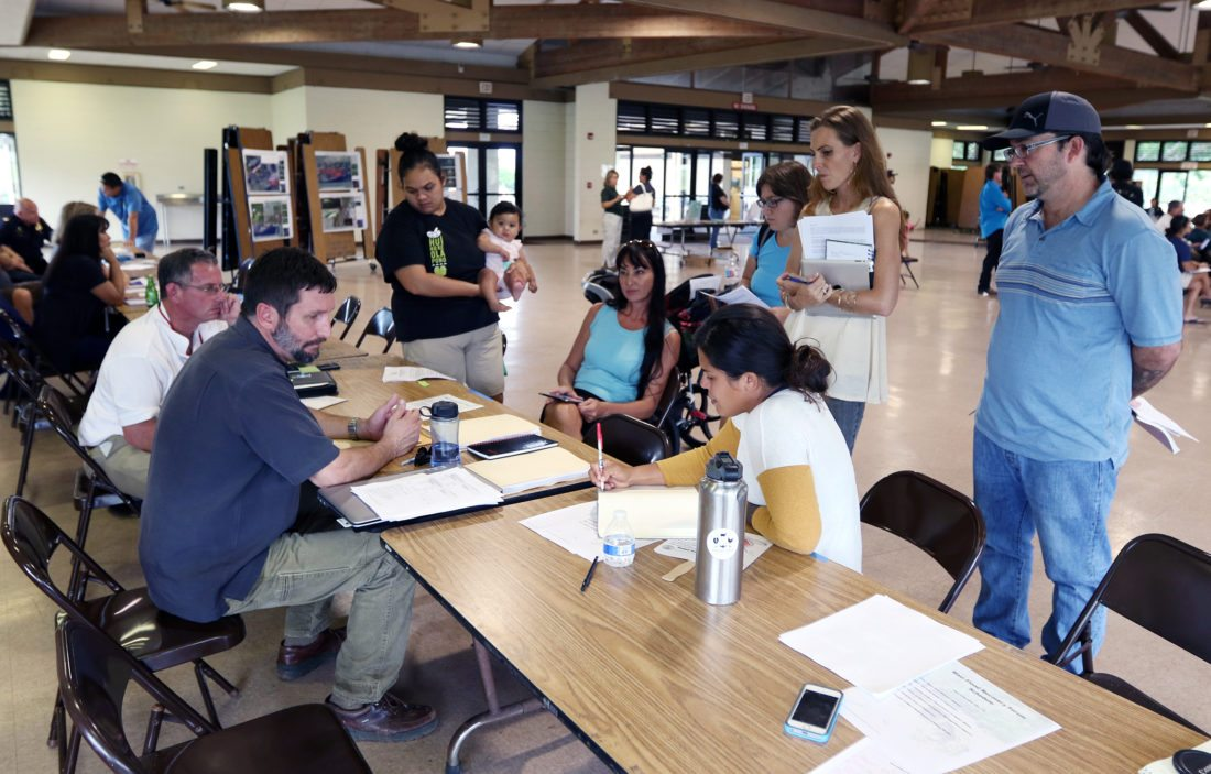 Maui residents and Native Hawaiian activists ask Army Corps of Engineers officials questions Tuesday night during a forum at the Velma McWayne Santos Community Center. The Maui News / CHRIS SUGIDONO photo
