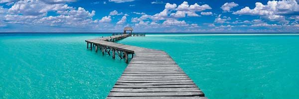 A panoramic photograph of a wharf in Mexico from a previous work by Peter Lik