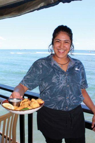 Server Maria Olea-Martinez brings island fish & chips, Hawaiian sea salt fries and housemade dill-caper sauce. The Maui News / CARLA TRACY  photo