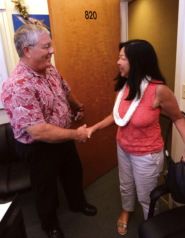 Maui County Council Member Don Couch (left) welcomes Council Member-elect Kelly King into his Council Chambers office Wednesday afternoon. Couch invited King to the office the day after the election to give her the lay of the land and to help her hit the ground running when she is sworn in to take over his seat in January. The Maui News / MATTHEW THAYER photo