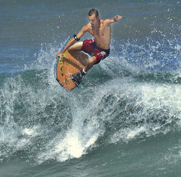 Surf's up in Paia: A bodyboarder cuts a sharp turn off the top of a wave at Paia Bay on Thursday afternoon. A high-surf warning has been posted for north-facing shores of Maui and Molokai and west-facing shores of Molokai until 6 p.m. today. The Maui News / MATTHEW THAYER photo