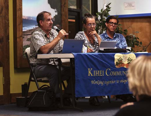 Wastewater consultant Steve Parabicoli (from left) speaks to more than 50 people Tuesday night with water-quality expert Robin Knox and attorney Lance Collins during a Kihei Community Association meeting at Kihei Charter Middle School. The Maui News / CHRIS SUGIDONO photo
