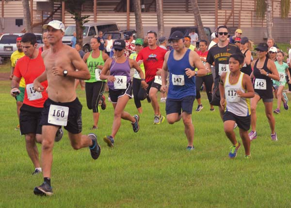 Runners take off from the starting line during the Sun, Surf and Hoops 5K on Sunday at Paradise Grill in Kaanapali. The Maui News / BRAD SHERMAN photo