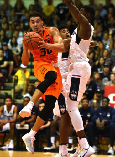 Oklahoma State's Jeffrey Carroll is guarded by Connecticut's Kentan Facey during the first half of the Cowboys' 98-90 win over the Huskies on Monday. The Maui News / MATTHEW THAYER photo