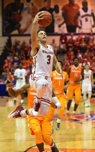 Wisconsin's Zak Showalter goes up for a shot in front of Tennessee's Shembari Phillips in the second half of the Badgers' 74-62 win over the Volunteers on Monday. The Maui News / MATTHEW THAYER photo