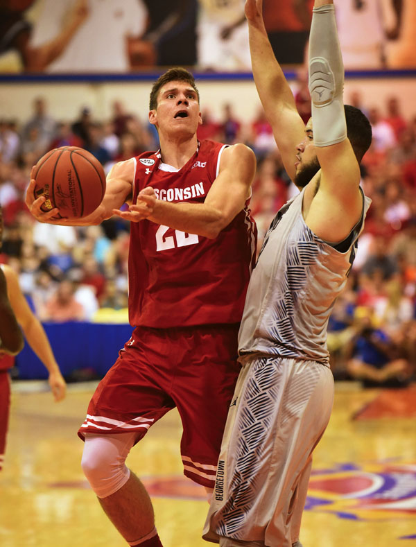 Wisconsin's Ethan Happ goes to the hoop as Georgetown's Bradley Hayes defends during the first half of the Badgers' 73-57 win over the Hoyas on Tuesday. The Maui News / MATTHEW THAYER photo