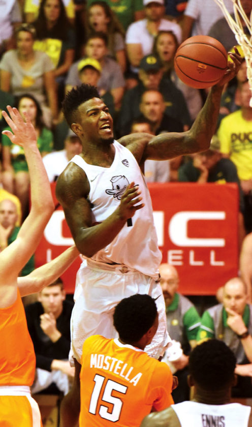 Jordan Bell of the Ducks goes up for a shot over the Vols' Detrick Mostella. The Maui News / MATTHEW THAYER photo