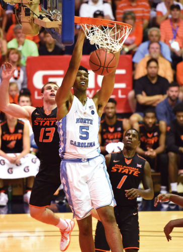 North Carolina's Tony Bradley dunks between Oklahoma State's Phil Forte and Juwan Evans during the first half of the Tar Heels' 107-75 victory over the Cowboys on Tuesday in a Maui Jim Maui Invitational semifinal game at the Lahaina Civic Center. The Maui News / MATTHEW THAYER photo