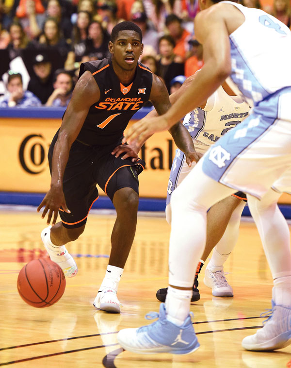 The Cowboys' Jawun Evans dribbles upcourt in the second half. The Maui News / MATTHEW THAYER photo