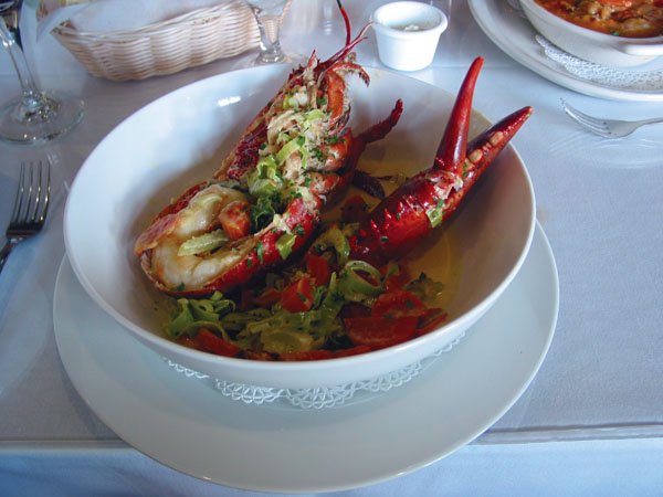 Cafe del Vino at Maalaea Harbor will dish up classic entrees such as half Kona lobster waterzooi in curry cream sauce as a sunset special when it reopens after a needed Thanksgiving Day off for the staff. The Maui News / CARLA TRACY photo