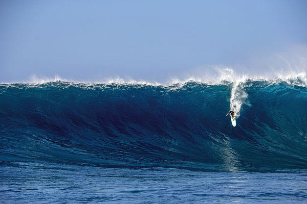 Ian Walsh slices down a big wave at Jaws at Peahi. Zak Noyle for Red Bull Media House photo