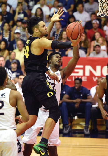 Oregon's Dillon Brooks heads toward the hoop as Connecticut's Steven Enoch defends during the first half of the Ducks' 79-69 win over the Huskies on Wednesday in the fifth-place game. The Maui News / MATTHEW THAYER photo