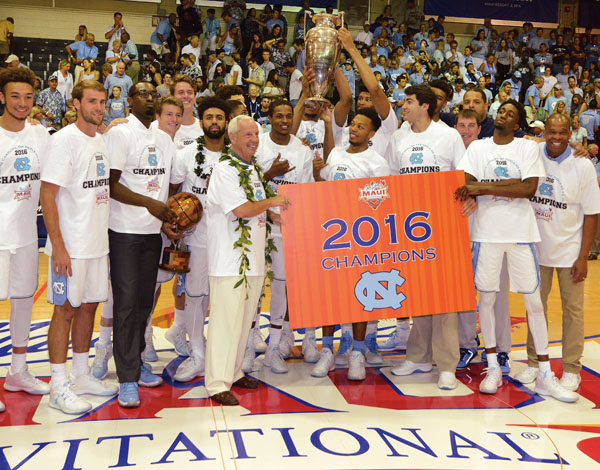 North Carolina players and coaches pose after claiming the Maui Jim Maui Invitational title with a 71-56 win over Wisconsin on Wednesday at the Lahaina Civic Center. The Maui News / MATTHEW THAYER photo