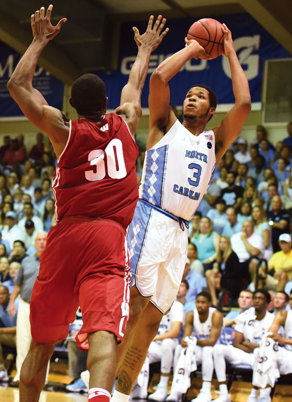The Tar Heels' Kennedy Meeks puts up a baseline jump shot as the Badgers' Vitto Brown defends during the second half. The Maui News / MATTHEW THAYER photo