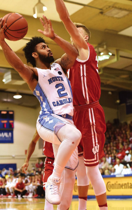 Joel Berry II of North Carolina is guarded by Wisconsin's Zak Showalter in the second half. The Maui News / MATTHEW THAYER photo