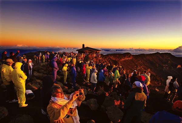With sunrise crowds growing beyond the capacity of parking lots at Haleakala National Park, a reservation system is set to begin in February as a pilot program. Cost will be $1.50 and can be booked up to 60 days in advance. The Maui News / MATTHEW THAYER photo