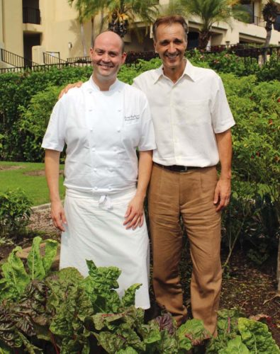 Four Seasons Resort Maui Executive Chef Craig Dryhurst (left) and General Manager Jean Claude Wietzel in the hotel's organic garden. The Maui News / CARLA TRACY photo