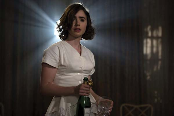 "Lily Collins stars in ""Rules Don't Apply."" Twentieth Century photo via AP"