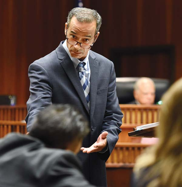 Anticipating an objection in his charged final arguments Wednesday morning, defense attorney Jon Apo gestures to Maui County First Deputy Prosecuting Attorney Robert Rivera. Apo was making his case to the jury in the murder trial of Steven Capobianco. The Maui News / MATTHEW THAYER photo