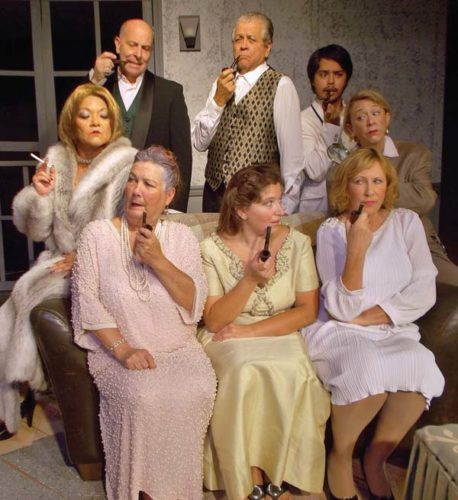 "Kathy Collins (back row, from left), Scott Smith, Bill Hubbard, Isaac Rauch, Rochelle Dunning, and  Barbara Sedano (front row, from left), Adriane Raff Corwin and Victoria McGee star in  ""The Games Afoot: Or Holmes for the Holidays."" JACK GRACE photo"