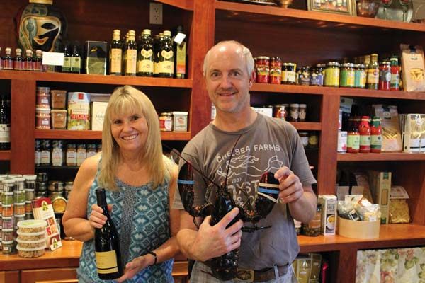 Culinary experts Diane Stanislaw (wife of chef  Alex Stanislaw of Sea House in Napili) and Will Hawkins are happy to educate you on wine picks, cheese pairings, and getting live Maine lobsters out of the tank. The Maui News / CARLA TRACY photo