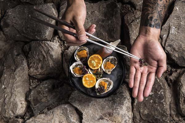 Freshly shucked Pacific oysters topped with uni, or sea urchin, shiso and Hawaiian chili pepper water will be among festive pupu at Bubbles and Bites at The Banyan Tree in The Ritz-Carlton, Kapalua from 5:30 to 7 Wednesday evening. The Ritz-Carlton, Kapalua photo