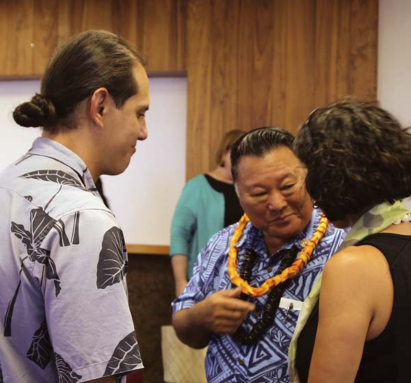 Mayor Alan Arakawa (center) talks with former Earthjustice attorney Kapua Sproat (right) and Hui o Na Wai Eha Vice President Hokuao Pellegrino following a news conference Wednesday in Wailuku. The mayor announced a tentative agreement for the county to purchase Wailuku Water Co.'s ditch system and 8,764 acres of its West Maui Mountain watershed lands. County of Maui / LOIS WHITNEY photo