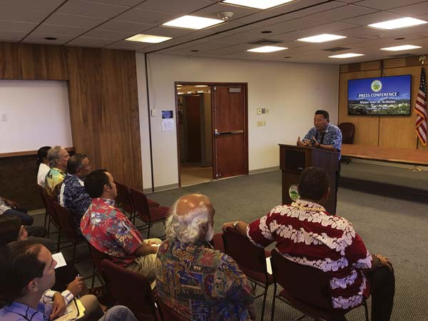 Mayor Alan Arakawa discusses a proposal for Maui County to purchase 8,764 acres of West Maui Mountain watershed lands and Wailuku Water Co.'s ditch water delivery system for $9.5 million during a news conference Wednesday. County of Maui / LOIS WHITNEY photo